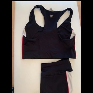 2 piece black trimmed with white athletic wear